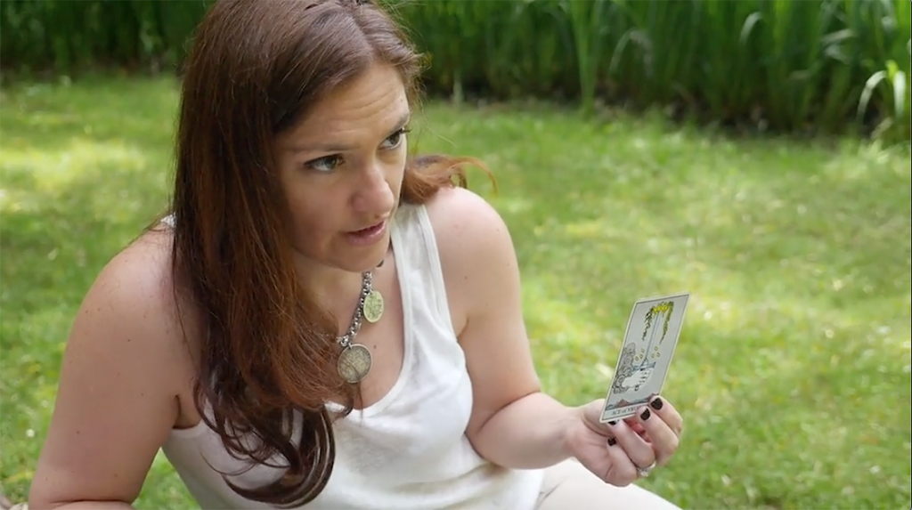 Sasha Graham reading Tarot